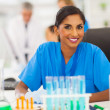 Stock Photo: Young indian researcher working in lab