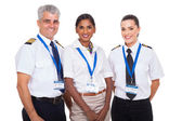 Airline crew standing on white background — Stock Photo