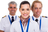 Flight attendant standing in front of pilots — Stock Photo