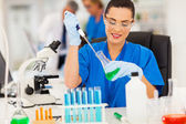Lab technician handling liquid in lab — Stock Photo