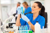 Young female scientist working with liquids in laboratory — Stock Photo