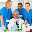 Senior scientist with group of chemistry students — Stock Photo