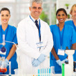 Senior microbiology specialist with students — Stock Photo