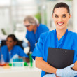 Attractive young female lab technician — Foto Stock