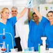 Successful team of scientists high five — Stock Photo
