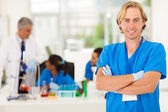 Medical researcher with arms crossed — Stock Photo