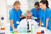 Group of scientists working in lab — Stock Photo