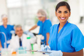 Young medical researcher writing report — Stock Photo