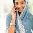 Stock Photo: Young Indiwomin traditional clothing talking on cellphone