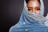 Indian woman in sari with her face covered — Stock Photo