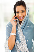 Young Indian woman in traditional clothing talking on cellphone — Stock Photo