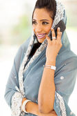 Indian woman talking on smart phone — Stock Photo