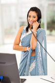 Indian office worker talking on the phone — Stock Photo
