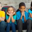 Stock Photo: Primary school children sitting outdoors