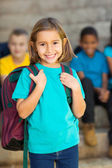 Cute elementary schoolgirl — Stock Photo