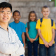 Handsome elementary school educator — Stock Photo #28921381