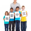 Chinese teacher standing with group of students — Stock Photo