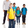 Boy standing in front of classmates and teacher — Stock Photo