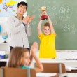 Male teacher applauding for student — Stockfoto