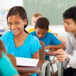 African american school girl in classroom — Stock Photo