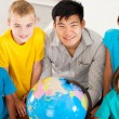 Stock Photo: Geography teacher with group of primary students