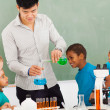 Elementary school chemistry experiment — Stock Photo
