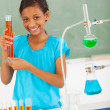 Female elementary school pupil in science class — Stock Photo