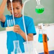 Elementary school student in science class — Stock Photo