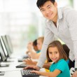 Elementary school computer teacher and students — Stock Photo