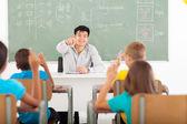 Handsome teacher teaching chinese in classroom — Stock Photo