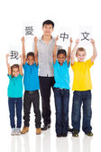 Group of pupils learning chinese with teacher — Stock Photo