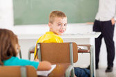 Primary school student looking back in classroom — Stock Photo