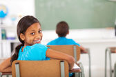 Primary school girl in classroom — Stock Photo
