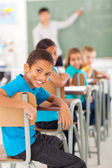 Elementary school boy in classroom looking — Stock Photo