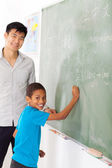 Elementary school chinese language teacher and student — Stock Photo