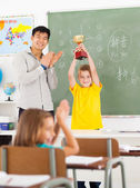 Male teacher applauding for student — Stock Photo