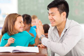 Elementary school teacher and student high five — Stock Photo
