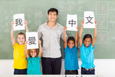 Male chinese teacher with group multiracial students — Stok fotoğraf