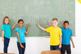 Primary school students pointing their chinese writing work — Stock Photo