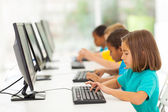 Elementary school students in computer class — Stockfoto