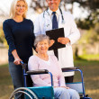 Disabled senior woman and daughter meeting retirement village do — Stock Photo