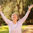 Stock Photo: Healthy elderly womarms outstretched