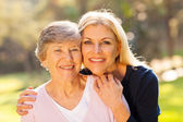 Senior woman and middle aged daughter — Stock Photo