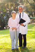 Senior woman and middle aged medical doctor — Stock Photo