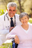 Medical doctor and elderly patient — Stock Photo