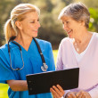 Stock Photo: Caregiver and senior patient