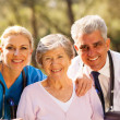 Healthcare workers and senior patient — Stock Photo