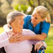 Stock Photo: Caring nurse with senior patient