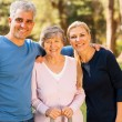 Stock Photo: Mid age couple and senior mother outdoors