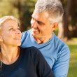 Loving middle aged couple embracing — Stock Photo